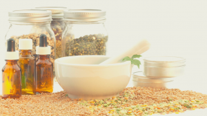 naturopath herbs and herbal tonics with mortar and pestle